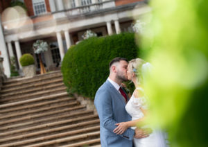 Bride Groom Kissing Near Steps Eaves Hall Hotel Wedding Photography